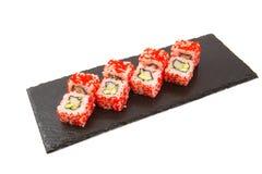 Tasty sushi on white background. Sushi isolated on shale food board on white background stock photography