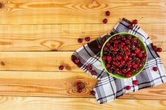 Tasty sweet cherry on wooden background. Top view royalty free stock photography
