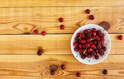 Tasty sweet cherry on wooden background. Top view stock photography