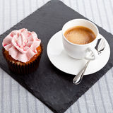 Tasty sweet cupcake and hot aromatic espresso coffee Stock Photo