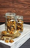 Tasty sweet and healthy snacks walnuts in a glass. Jar in a wooden box white board Stock Photo