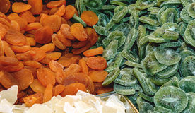 Tasty sweet mix colorful dried fruits. Kiwi, apricot. Stock Photo