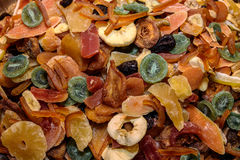 Tasty sweet mix colorful dried tropical exotic fruits. Pineapple, apple, banana, papaya, kiwi, guava, mango Royalty Free Stock Photo