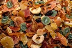 Tasty sweet mix colorful dried tropical exotic fruits. Pineapple, apple, banana, papaya, kiwi, guava, mango Royalty Free Stock Photo