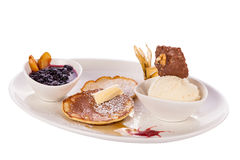 Tasty sweet pancakes with vanilla icecream and topping Stock Photography