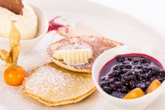 Tasty sweet pancakes with vanilla icecream and topping Stock Images