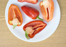 Tasty sweet peppers on white plate top view closeu Royalty Free Stock Image