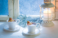 Tasty and sweet two gingerbread man in cocoa for Christmas Stock Images