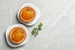 Tasty tartlets with jam on light background. Top view Royalty Free Stock Photography