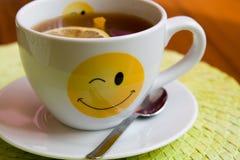 Tasty tea with cinnamon, cloves and lemon Stock Photo