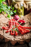 Tasty thin sausages in cellar Royalty Free Stock Photo