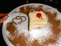 Tasty tiramisu plate with hearts Stock Photography
