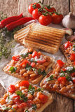 Tasty toast with white beans, tomatoes, cheese and garlic close- Royalty Free Stock Photos