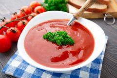 Tasty tomato soup with herbs Stock Photo