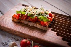 Tasty tomatoes bruschetta Stock Photo