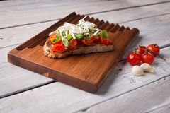 Tasty tomatoes bruschetta royalty free stock photography