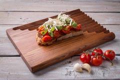 Tasty tomatoes bruschetta stock photography