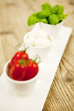 Tasty tomatoes mazarella and basil on plate on table Royalty Free Stock Photos