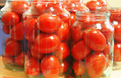 Tasty tomatoes ready to canned in glass jar Stock Photo