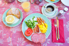 Tasty traditional appetizing yummy breakfast at the restaraunt outdoors. Fresh coffee and croissant. Tasty traditional appetizing yummy breakfast at the royalty free stock image