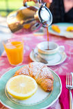 Tasty traditional appetizing yummy breakfast at the restaraunt outdoors. Fresh coffee and croissant. Tasty traditional appetizing yummy breakfast at the royalty free stock images