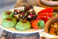 Traditional georgian food : Badridżani and stuffed vegetables Royalty Free Stock Photography