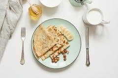 Tasty traditional russian breakfast pancakes, milk, sour cream, honey. Springtime. Shrovetide. Tasty traditional russian breakfast pancakes, sour cream, milk royalty free stock image