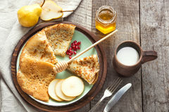 Tasty traditional russian breakfast of slapjack with honey on plate. Rustic style. Space for your text. Stock Photos