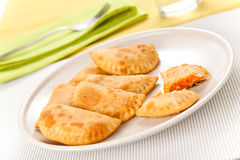 Tasty tuna patty with tomato and pepper Stock Image