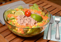 Tasty tuna salad. Tuna salad with carrots,olives,onion,lettuce,lime and tomato Stock Photo