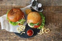 Tasty turkey burgers. On slate plate Stock Photography