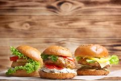 Tasty turkey burgers. On table Royalty Free Stock Images
