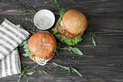 Tasty turkey burgers. On wooden background Stock Image