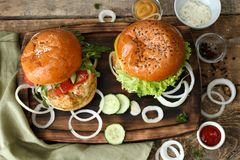 Tasty turkey burgers. On wooden board Stock Images