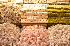 Tasty Turkish delight ready to sell. Nuts and peanuts in the Turkish delight royalty free stock photos