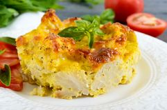 Tasty useful casserole from cauliflower on a plate on a dark wooden background. Stock Photography