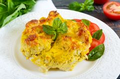 Tasty useful casserole from cauliflower on a plate on a dark wooden background. Stock Images