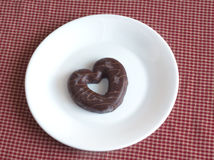 Tasty Valentine's Day. Chocolate covered cookie on a plate Stock Photography