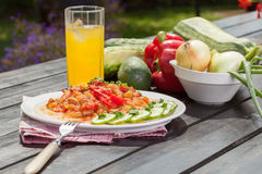 Tasty vegetable dish. On wooden table stock photography