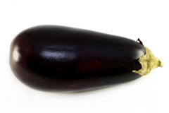 Tasty vegetable eggplant. Photographed closeup on a white background Royalty Free Stock Photos