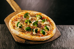 Tasty vegetable pizza with broccoli and mushrooms Stock Images