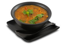 Tasty vegetable soup on white, isolated. Tasty vegetable soup served in stylish, black bowl, on white, isolated Stock Photo