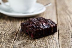 Tasty vegetarian brownie slice on wooden table for celebration. Stock Photography