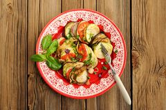Tasty vegetarian ratatouille made of eggplants, squash, tomatoes Royalty Free Stock Photography