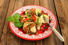 Tasty vegetarian ratatouille made of eggplants, squash, tomatoes Stock Images