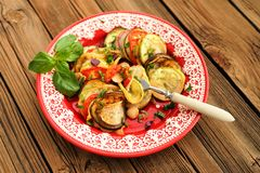 Tasty vegetarian ratatouille made of eggplants, squash, tomatoes Royalty Free Stock Images