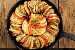 Tasty vegetarian ratatouille made of eggplants, squash, tomatoes Stock Photos