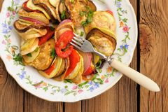 Tasty vegetarian ratatouille made of eggplants, squash, tomatoes Royalty Free Stock Photo