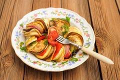 Tasty vegetarian ratatouille made of eggplants, squash, tomatoes Royalty Free Stock Photo