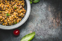 Tasty vegetarian red lentil salad in bowl on rustic background, top view, close up, border. Healthy eating royalty free stock photos